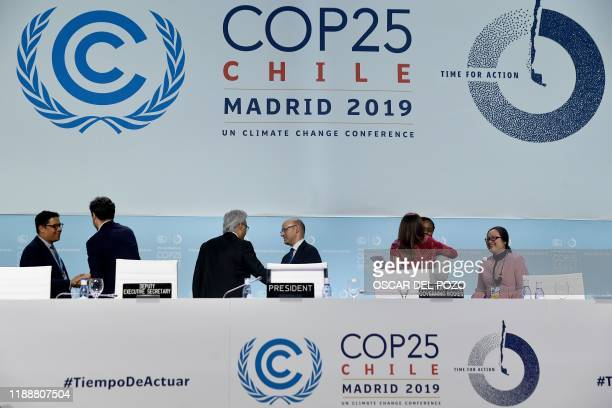 Delegates leave after the closing plenary session of the UN Climate Change Conference COP25 at the 'IFEMA Feria de Madrid' exhibition centre in...
