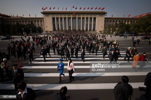 Delegates leave following the opening session of the Chinese Communist Party's five-yearly Congress at the Great Hall of the People in Beijing on...
