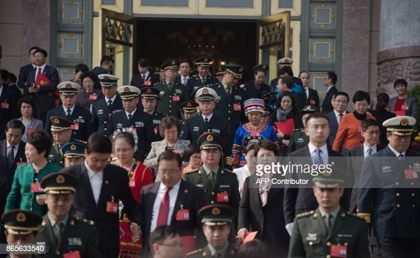 Delegates leave the Great Hall of the People after the closing session of the 19th Communist Party Congress in Beijing on October 24, 2017. Xi...