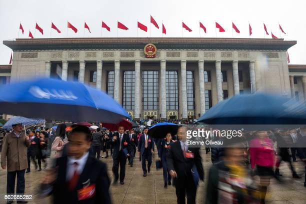 Delegates leave the Great Hall of the People after the opening session of the 19th Communist Party Congress on October 18, 2017 in Beijing, China....