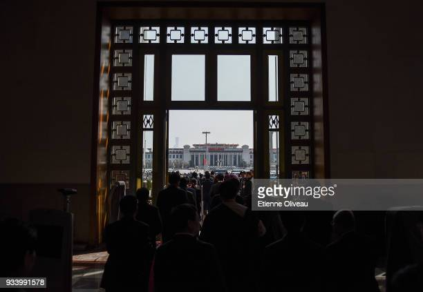 Delegates leave the Great Hall of the People after the seventh plenary session of the 13th National People's Congress on March 19, 2018 in Beijing,...