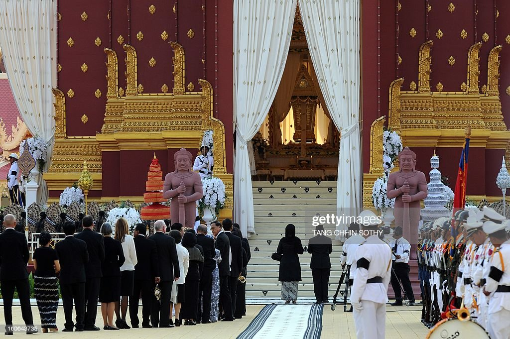 Delegates line up to pray during the cremation of Cambodia's King Norodom Sihanouk near the Royal Palace in Phnom Penh on February 4, 2013. Thousands of mourners massed in the Cambodian capital as the kingdom cremated its revered former King Norodom Sihanouk, who steered his country through six turbulent decades.
