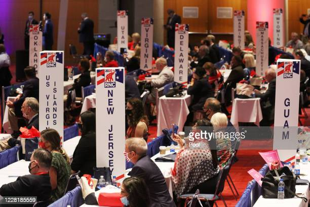 Delegates listen as Vice President Mike Pence speaks on the first day of the Republican National Convention at the Charlotte Convention Center on...