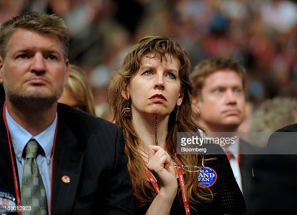 Delegates listen at the Republican National Convention in Tampa Florida US on Thursday Aug 30 2012 Republican presidential nominee Mitt Romney a...