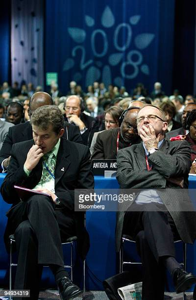 Delegates listen in the main plenary hall where international discussions take place at the United Nations Climate Change Conference in Poznan Poland...