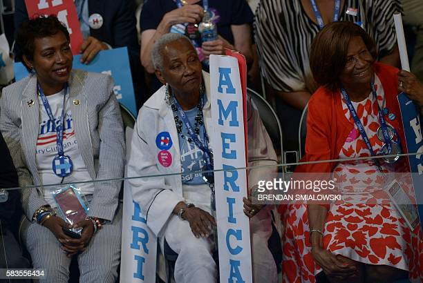 Delegates listen to former President Bill Clinton addressing delegates on Day 2 of the Democratic National Convention at the Wells Fargo Center in...