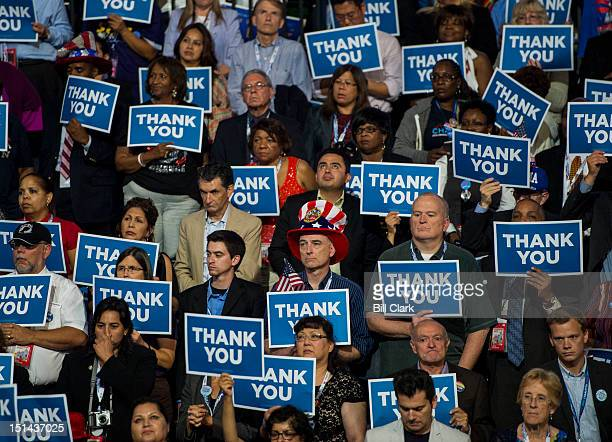 Delegates listen to President Barack Obama's speech at the Democratic National Convention at Time Warner Cable Arena in Charlotte NC on Thursday Sept...