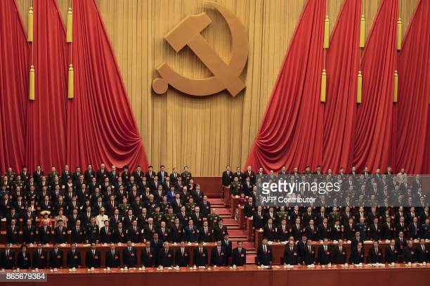 Delegates listen to the Internationale at the end of the closing session of the 19th Communist Party Congress at the Great Hall of the People in...