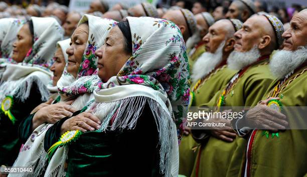 TOPSHOT Delegates listen to the national anthem at a meeting of the Council of the Elders outside Ashgabat on October 9 2017 Turkmenistan's autocrat...