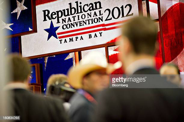 Delegates mingle on the floor of the Republican National Convention in Tampa Florida US on Monday Aug 27 2012 The first day of the RNC is formally...