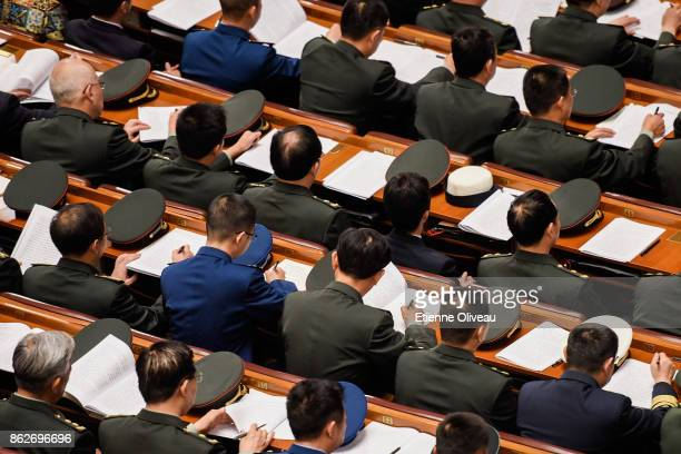 Delegates of the army attend the opening session of the 19th Communist Party Congress held at the Great Hall of the People on October 18, 2017 in...