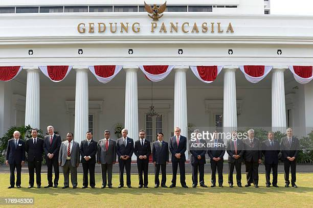 Delegates of the Conference on Irregular Movement of Persons general director of the IOM William L Swing Pichel Wangtepanukhor advisor to the Thai...