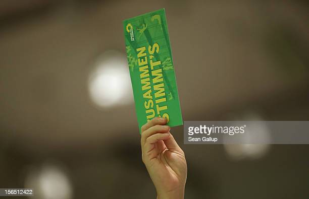 Delegates of the German Greens Party vote on a measure at the Greens Party federal convention on November 16 2012 in Hanover Germany Germany faces...