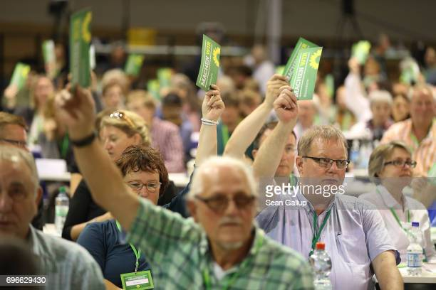 Delegates of the German Greens Party vote on a preliminary measure on the first day of the Greens Party federal congress on June 16 2017 in Berlin...