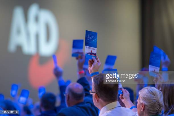 Delegates of the rightwing Alternative for Germany political party cast their votes during the AfD federal congress on June 30 2018 in Augsburg...