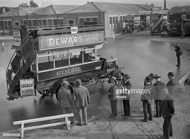 Delegates of the US Bureau of Roads watching watching a London General Omnibus Company Btype doubledecker bus bus being driven on a skid pan 7th...