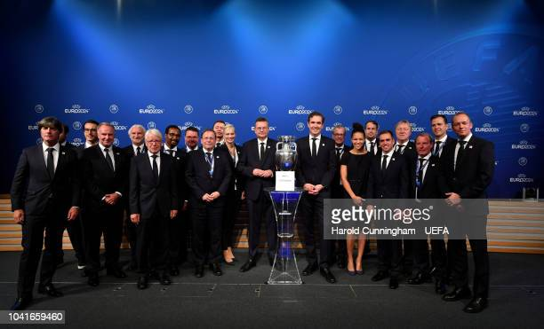 Delegates on stage with the UEFA European Championship trophy following the announcement of Germany as the bid winners during the UEFA EURO 2024 host...