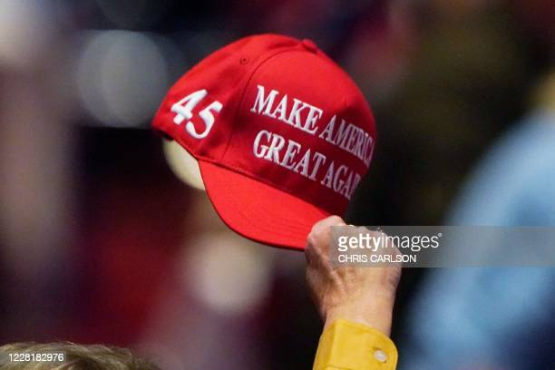 Delegates participate during the opening of the first day of the Republican National Convention, meeting in the Richardson Ballroom, Charlotte...