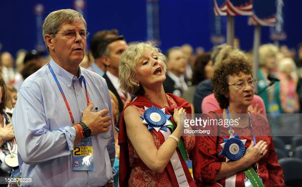 Delegates participate in the Pledge of Allegiance at the Republican National Convention in Tampa Florida US on Tuesday Aug 28 2012 Delegates are...