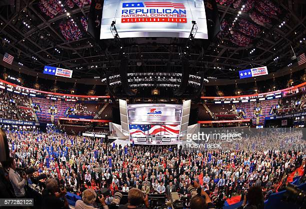 TOPSHOT Delegates pose for an official convention photograph on the opening day of the Republican National Convention at the Quicken Loans arena in...