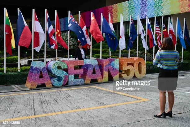 ASEAN delegates pose for pictures during the 31st Association of Southeast Asian Nations Summit in Manila on November 13 2017 World leaders are in...