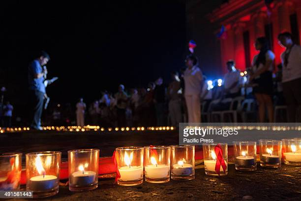 Delegates pray for the individuals that have perished due to HIVAIDS at the 31st International AIDS Candlelight Memorial at the Liwasang Bonifacio in...