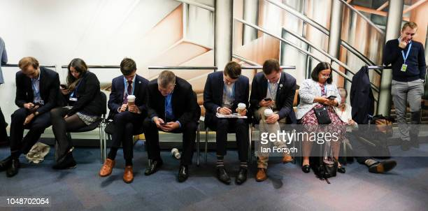 Delegates queue at the start of the final day of the Conservative Party Conference at the International Convention Centre which will feature the...
