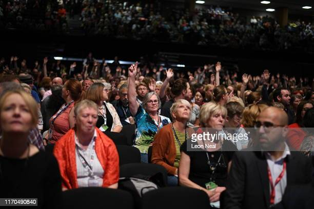 Delegates raise their hands to be chosen to speak on the third day of the Labour Party conference on September 23 2019 in Brighton England Labour...