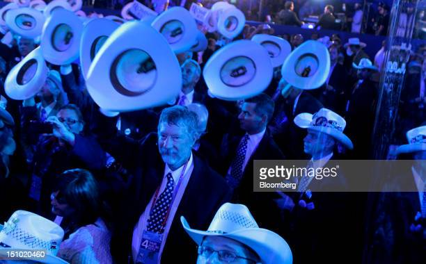 Delegates raise their hats at the Republican National Convention in Tampa Florida US on Thursday Aug 30 2012 Republican presidential nominee Mitt...
