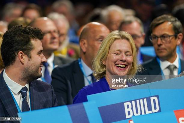 Delegates react as they wait to listen to Prime Minister Boris Johnson's keynote speech during the Conservative Party conference at Manchester...