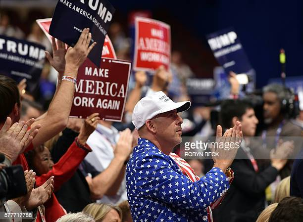 Delegates react to Donald Trump's son Donald Trump Jr addressing the audience on the second day of the Republican National Convention on July 19 2016...