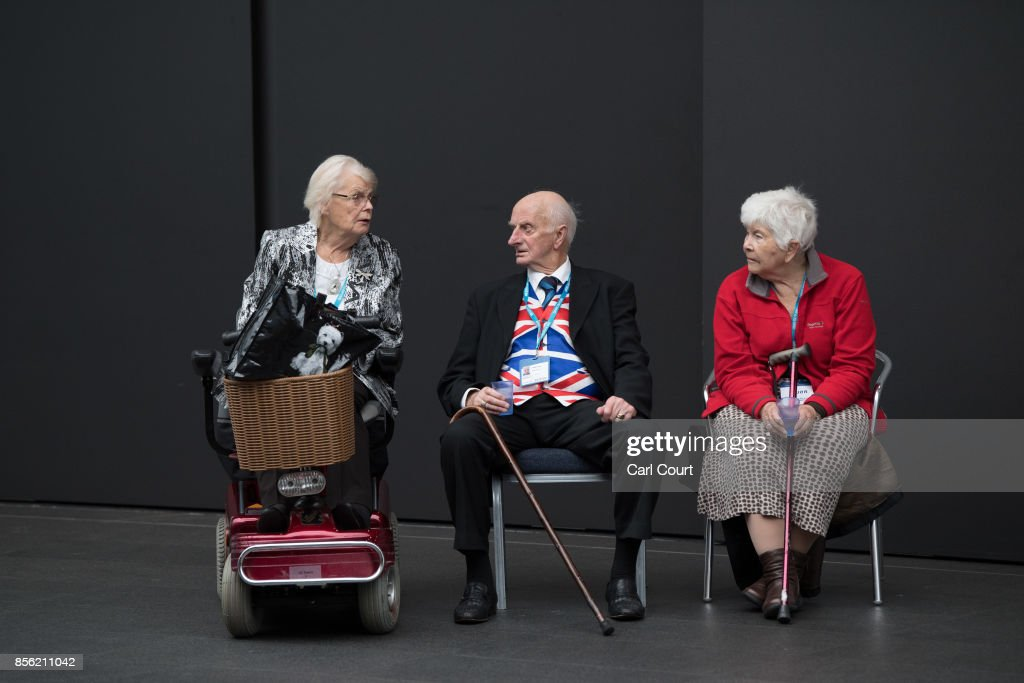 Delegates relax on the first day of the annual Conservative Party conference, October 1, 2017 in Manchester, England. Ministers and senior party members will address delegates throughout the day with a number of speeches discussing the party's plans for the next twelve months.