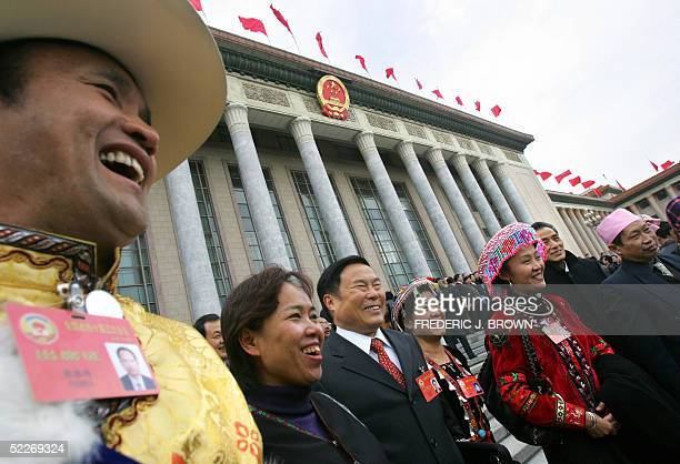 Delegates representing some of China's 56 ethnic minorities arrive at the Great Hall of the People for of the opening session of the Chinese People's...