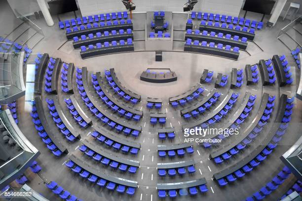 Delegates' seats are seen at the plenary hall of the Bundestag on September 27 2017 in Berlin three days after general elections / AFP PHOTO / John...