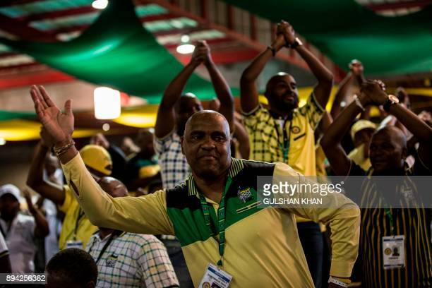 Delegates sing and dance during a plenary meeting at the NASREC Expo Centre during the 54th ANC national congress on December 17 2017 in Johannesburg...