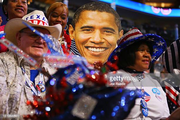 Delegates sit around a large cutout of the head of Democratic presidential candidate US President Barack Obama during the final day of the Democratic...