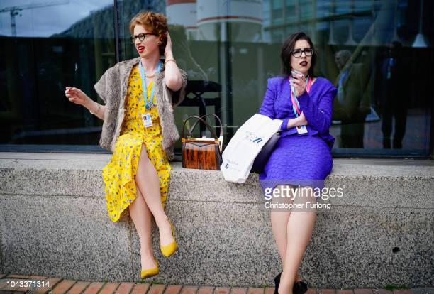 Delegates smoke outside during the annual Conservative Party Conference on September 30 2018 in Birmingham England The Conservative Party Conference...