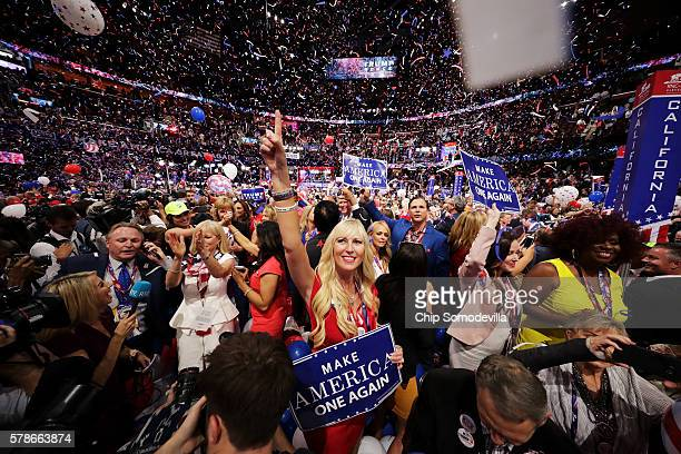 Delegates stand and cheer at the end of the Republican National Convention on July 21, 2016 at the Quicken Loans Arena in Cleveland, Ohio. Republican...
