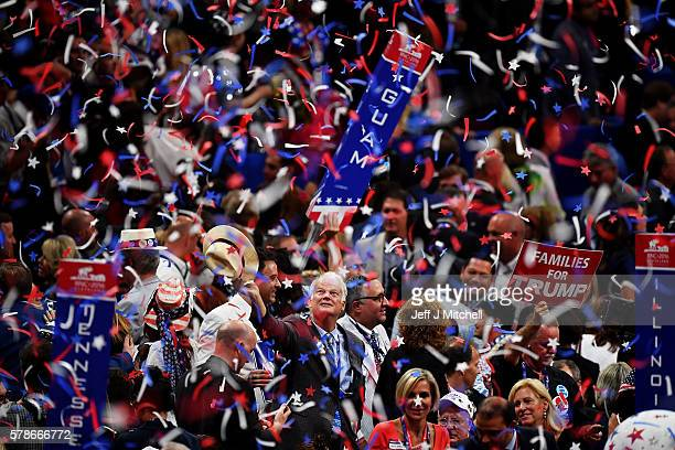 Delegates stand and cheer at the end of the Republican National Convention on July 21 2016 at the Quicken Loans Arena in Cleveland Ohio Republican...