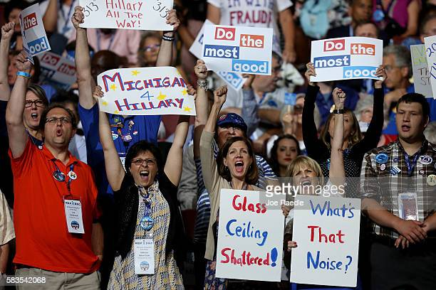 Delegates stand and cheer during the second day of the Democratic National Convention at the Wells Fargo Center July 26 2016 in Philadelphia...