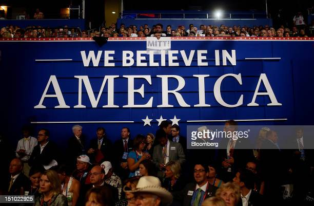 Delegates stand at the Republican National Convention in Tampa Florida US on Thursday Aug 30 2012 Republican presidential nominee Mitt Romney a...