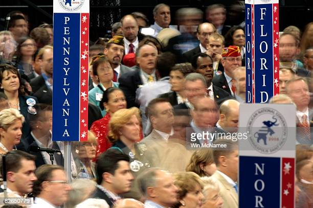 Delegates stand on the floor on day three of the Republican National Convention at the Xcel Energy Center on September 3 2008 in St Paul Minnesota...