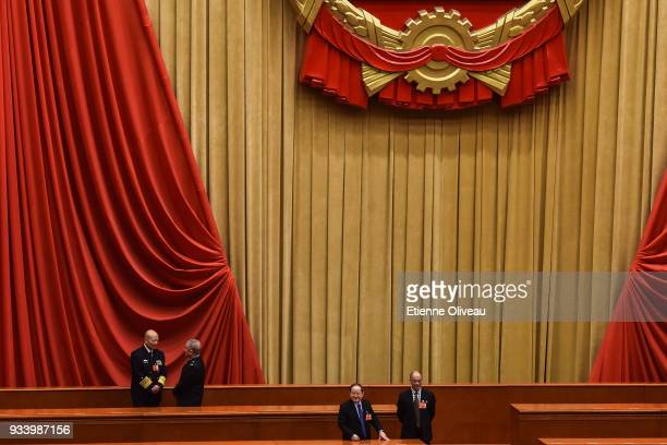 Delegates talk during the break after the vote during the seventh plenary session of the 13th National People's Congress at the Great Hall of the...