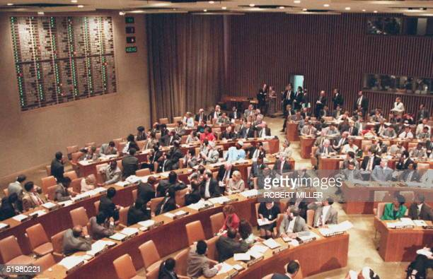 Delegates to the United Nations turn to watch the electronic tabulation of their vote on a comprehensive global nuclear testban treaty 10 September...