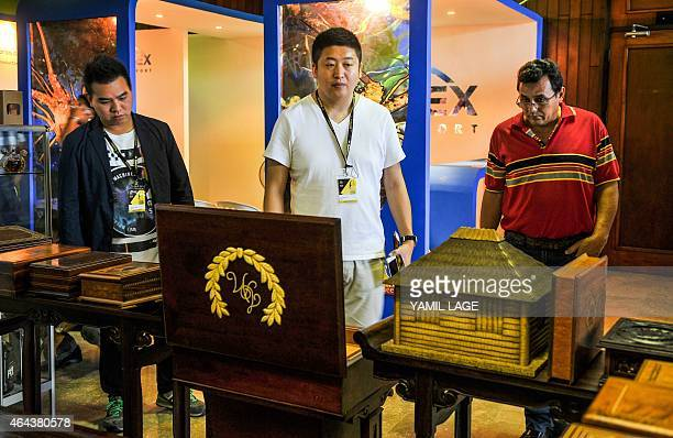 Delegates to the XVII Havana Cigar Festival look at a humidor at Convention Palace in Havana on February 25 2015 The world's largest Cuban cigar...
