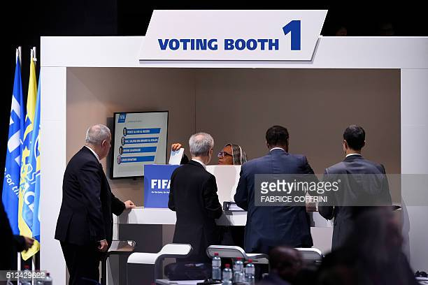 TOPSHOT Delegates vore for a new FIFA president during the extraordinary FIFA Congress in Zurich on February 26 2016 AFP PHOTO / FABRICE COFFRINI /...
