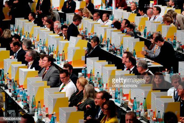 Delegates vote behind portable cardboard voting cabins during a congress of Germany's conservative Christian Democratic Union party on December 7...