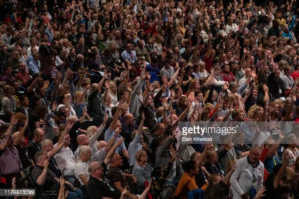 Delegates vote on a motion on the third day of the Labour Party conference on September 23, 2019 in Brighton, England. Labour Conference will debate...