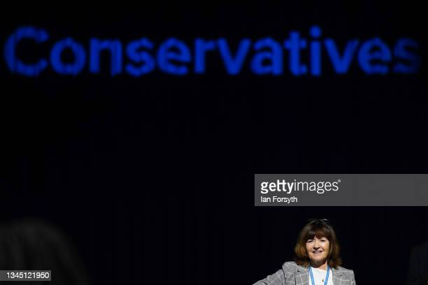 Delegates wait to listen to Prime Minister Boris Johnson's keynote speech during the Conservative Party conference at Manchester Central Convention...