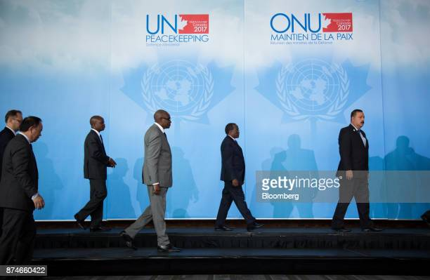 Delegates walk across a stage before a family photo during the 2017 UN Peacekeeping Defence Ministerial conference in Vancouver British Columbia...